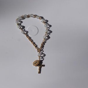 Women`s gold tone rosary bracelet. 8 inches long.